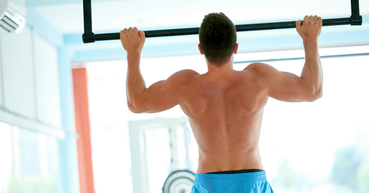 Young-guy-performing-pull-ups