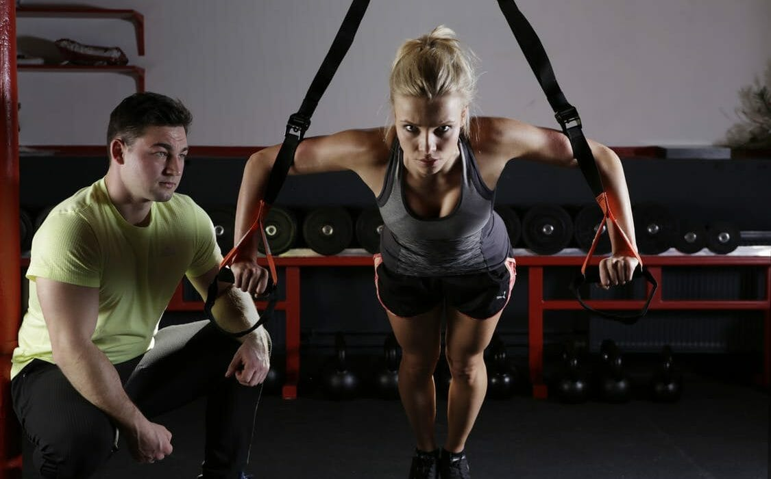 women-doing-trx-incline-pushups