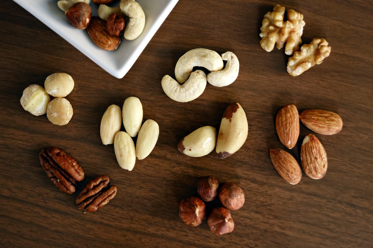 variety of brown nuts on brown wooden panel high angle photo 1295572