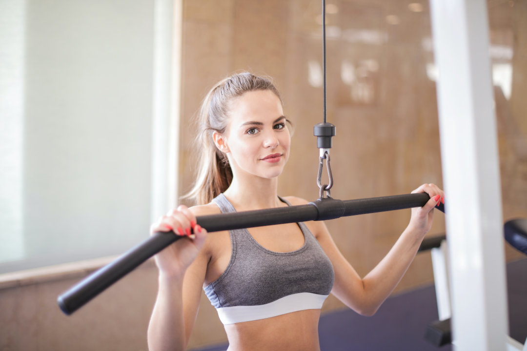 photo of woman performing lat pulldown