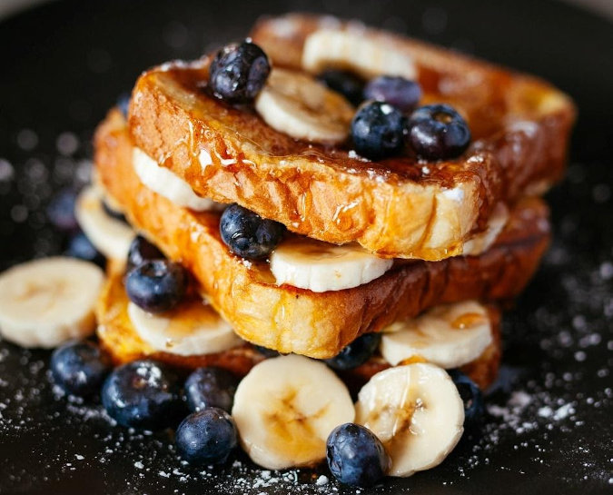 french toast with bananas and blueberries